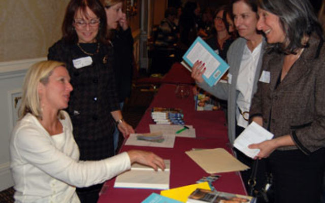 Author and television personality Lee Woodruff signs copies of her book at the NCJW Essex County Section's opening event.