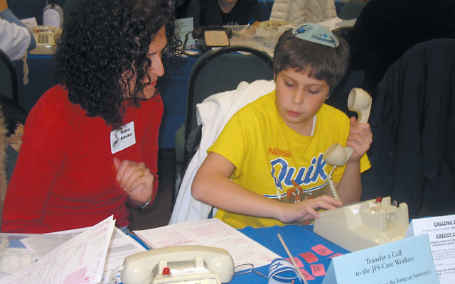 Volunteers of all ages made phone calls at last year's Super Sunday. Photo by Johanna Ginsberg