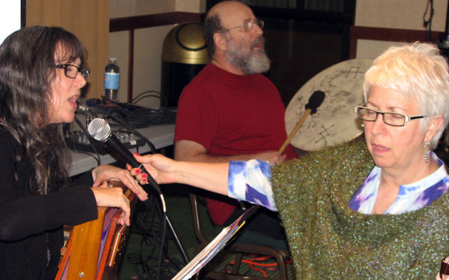 Miriam Maron chants as Gershon Winkler beats the drum at a session they led on Kabala and chanting at the Marriott Hotel in West Orange on May 12. Photo by Johanna Ginsberg