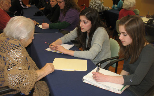 """Teens Margot Fitzgerald, center, and Clarissa Ford compared their lives in West Orange to that of Daughters of Israel resident Gitel Mezheritsky, who was born in Lithuania. """"Hers was a lot harder and we feel really grateful,"""" said Margot."""