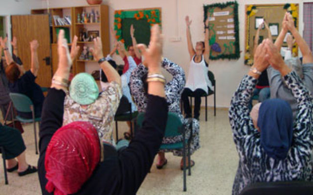 Senior residents of Ofakim learn well-being through yoga in a class organized by Leslie Gurland and the instructors she brought to Israel.