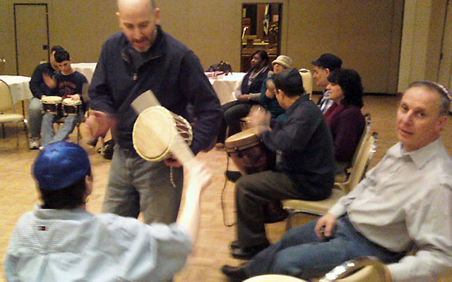 Drum maven David Malchman leads a Saturday evening Havdala/Melava Malka Drumming Madness program at the Feb. 5-6 Shabbat Shalem Weekend at Congregation B'nai Israel in Millburn. The weekend also included a Friday night family service.