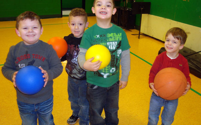 Kids from the Appalachian town of McRoberts enjoy balls donated last year through the efforts of the Good People Fund. Photo courtesy The Good People Fund