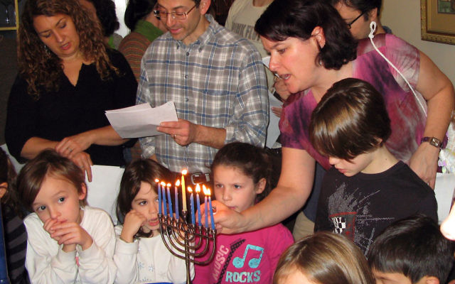Montclair Jewish Workshop families celebrated Hanukka together Dec. 19 at their own gathering, pictured, held in a member's home. But this year, some MJW families also attended a Hanukka service and dinner at Congregation Beth Ahm of West Essex in V