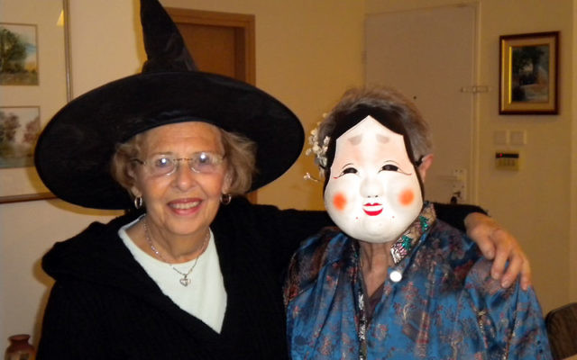 Terry Polaner, left, and her cousin Judy Kugelmass celebrate Purim together in Jerusalem. Photos courtesy Terry Polaner