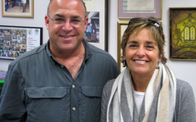 Yossi Katz and Ellen Goldner tout the programs of Alexander Muss High School as they launch a recruiting drive in MetroWest.