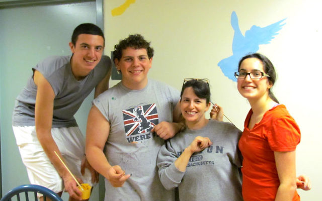 Isaac Feldman, left, painted a mural at Covenant House, a youth crisis center in Newark, as part of his participation in the Diller Teen Fellows Program; with him are, from left, Diller peers Zoe Wasserman, right, and Ben Stern and Diller coordinator and
