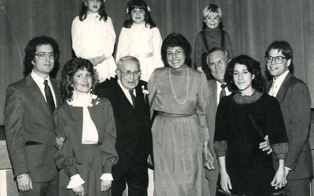 Ruth Fein, center, and family members celebrate the 90th birthday of her father, Sam Stein, in 1984, from left, front row, Mark Fien and his wife Susan, Sam Stein, Ruth's husband Jerome Fein, daughter Judie Fien-Helfman and her husband Jake; and, ba