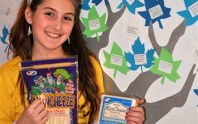 Candice Kleiman shows some of the healthy cheese alternatives she is selling for her mitzva project.
