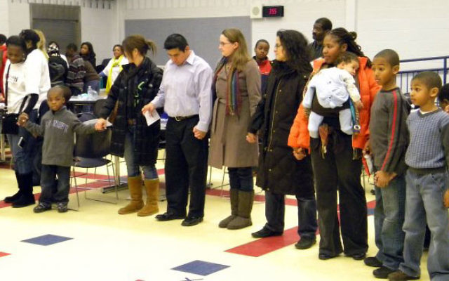 West Orange residents hold hands at a Jan. 31 vigil in support of relief efforts in Haiti.