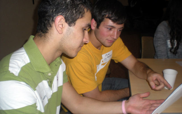 Students Alan Meskin, left, and Jonathan Pascheles consider how to effectively tackle an anti-Israel scenario on a college campus at the May 19 Israel Advocacy seminar.