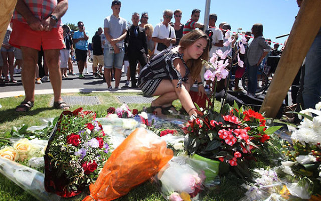 People visiting the scene and laying tributes to the victims of a terror attack on the Promenade des Anglais in Nice France, July 15, 2016.