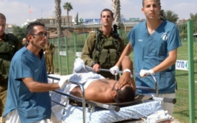 Israeli paramedics wheel an injured man on a stretcher at the Soroka Medical Center in Beersheba following a terrorist attack in southern Israel, near the Egyptian frontier, Aug. 18, 2011. (Dudu Greenspan/Flash 90)