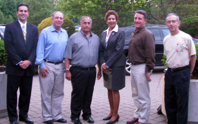 Attorney General of New Jersey Paula Dow with, from left, Essex County assistant prosecutor Brandon Minde; Temple B'nai Abraham president Edward Meinhardt; and TBA men's club former president Steve Delman, president Jeffrey Grabelle, and for