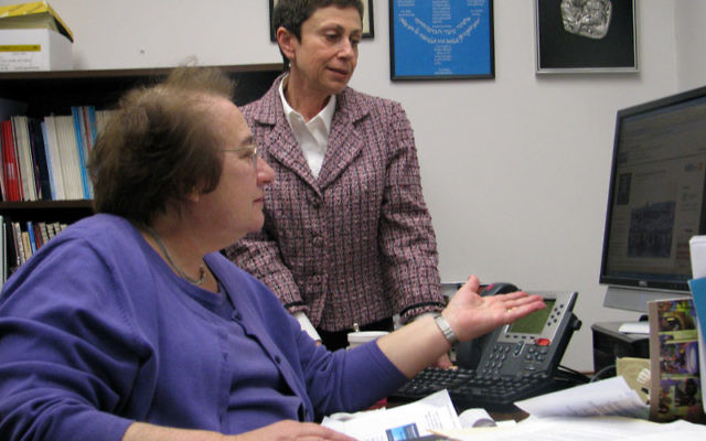Cecille Asekoff, left, director of the Joint Chaplaincy Committee of MetroWest and executive director of the National Association of Jewish Chaplains, and Kira Breytburd, Asekoff's coordinator of special projects, inspect the Internet for new develo