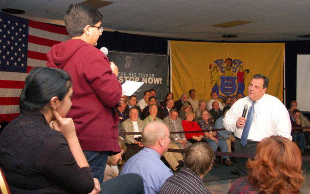 Twelve-year-old Surya Makkar questions Gov. Chris Christie at a Dec. 21 town hall meeting at the Knights of Columbus Hall in Spotswood. Photo courtesy Office of the Governor