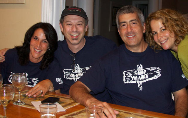 Adam Wolf, second from left, an organizer of the recent reunion of Passaic-Clifton Y campers, celebrates here with, from left, Ellen Jaffe Cawthorne, David Numark, and Gail Satkin Numark. Photo reprinted with permission from Adam Wolf