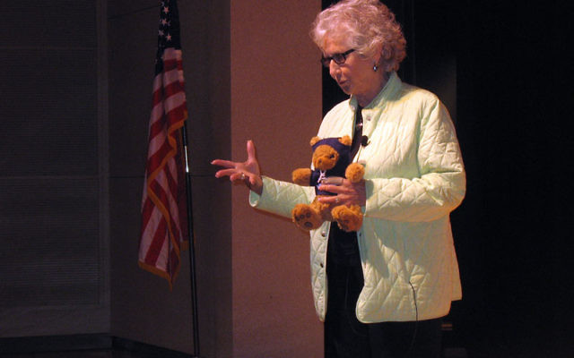 Maud Dahme responds to students questions on April 7 at a Holocaust education program at the College of Saint Elizabeth, shortly after being presented with a teddy bear, a luxury she never enjoyed as a child. Photos by Johanna Ginsberg