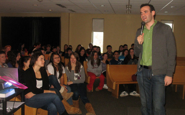Ari Teman, comedian and founder of JCorps, spoke with high school students at the Solomon Schechter Day School of Essex and Union on Jan. 20 after they completed a day of service.