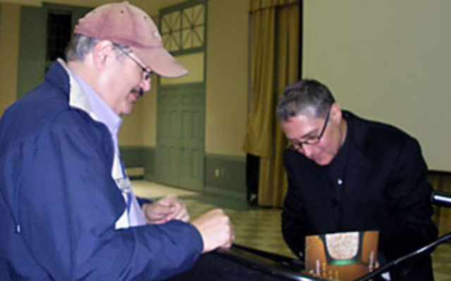 Jeffrey Shandler signs a copy of his latest book, Jews, God and Videotape: Religion and Media in America, following an Oct. 15 program at Rutgers University, Greeting the Season: The December Dilemma in American Jewish Popular Culture.