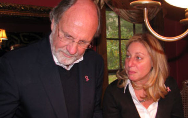 Jill LaZare, who is directing Jewish outreach for Gov. Jon Corzine in north Jersey, joins the governor at the buffet table after a meeting in her Summit home.