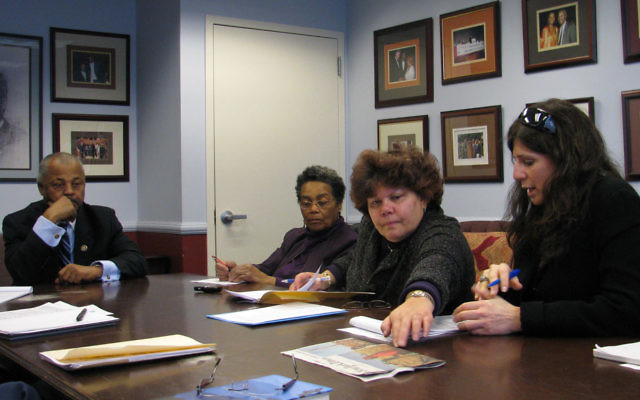 Rep. Donald Payne hears the concerns of, from left, Blanche Foster of the Darfur Rehabilitation Project, Ferne Hassan of the American Jewish Committee, and Melanie Roth Gorelick, representing the community relations arms of the Central NJ, Northern NJ and