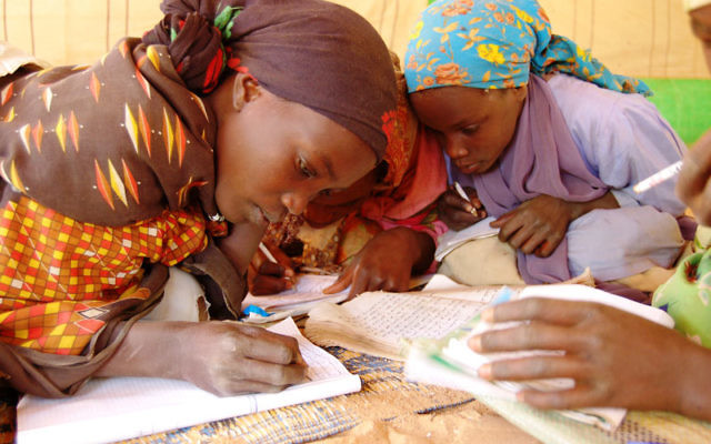 Darfurian students in class at the Oure Cassoni refugee camp in Chad. Photo by Melissa Winkler/International Rescue Committee