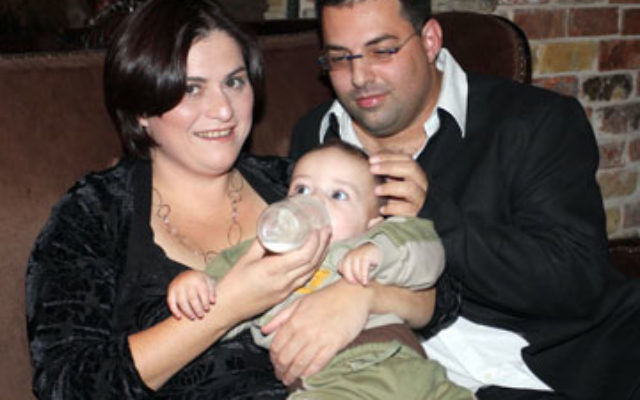 Yulia and Gili Ben Moshe with their son, Lavi, who suffers from Canavan disease