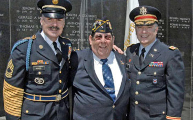 "Richard Dvorin, center, at the NJ Vietnam War Memorial at the PNC Bank Arts Center in Holmdel, where he leads a monthly support group for Vietnam veterans. With him are Master Sgt. Charles ""Chuck"" Arnold, left, of the NJ Army National Guard (R"