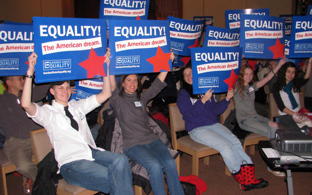 Supporters of same-sex marriage hold signs aloft during a rally at Bnai Keshet, the Reconstructionist synagogue in Montclair.
