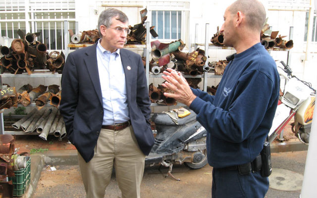 Rep. Rush Holt talks with a police sergeant in Sderot after inspecting evidence of rocket attacks during a February 2009 visit to Israel. Photo courtesy Rep. Rush Holt