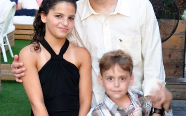 Yoram Behiri with his children at his daughter Gal's bat mitzva