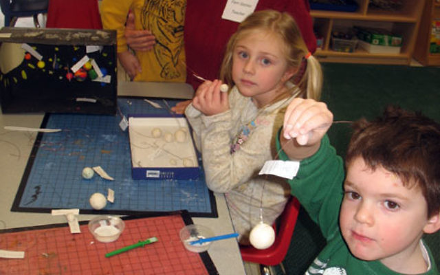 Children work on solar system projects in the Brody Early Childhood Center at the Aidekman campus in Whippany. The center is slated to close in June.