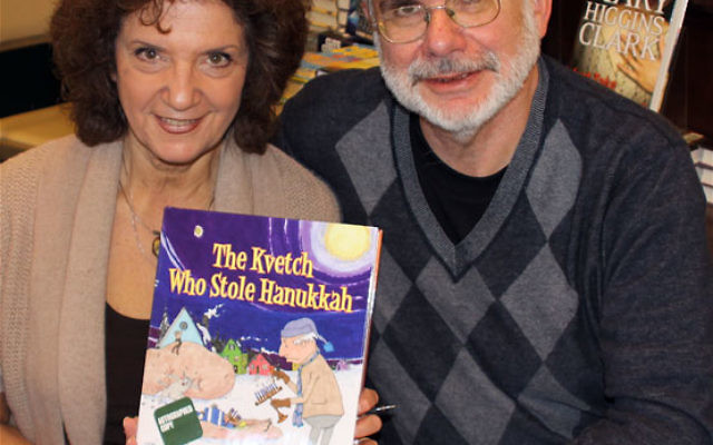 Susan Isakoff Berlin and Bill Berlin have published a book about Hanukka, complete with a kvetch who nearly spoils the holiday. Photo by Dave Benjamin, Greater Media News