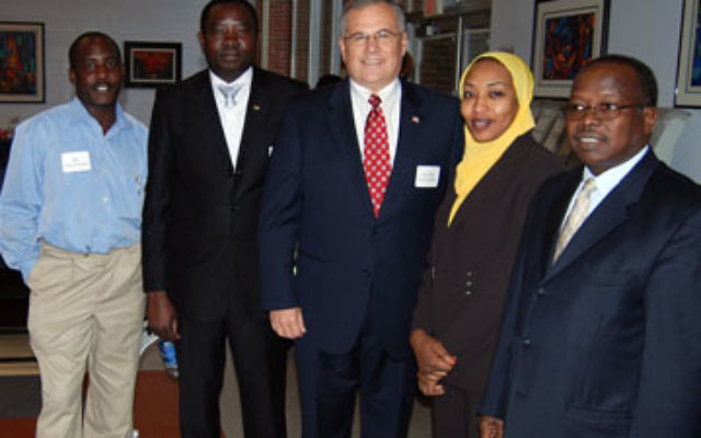 Before addressing the Darfur conference at Kean University, special envoy Gen. Scott Gration, center, spoke with Darfuri participants, from left, Adeeb Yousif, Yahya Osman, and Abdelbagy Abushanab.