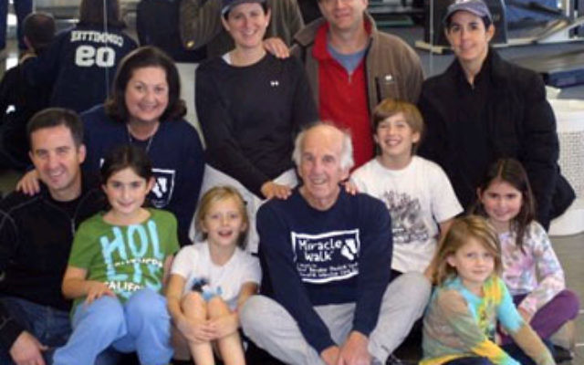 Peter Hirschmann, seated, who earned a Purple Heart in the Battle of the Bulge, with family members, from left, front row, son Jonathan, granddaughters Lauren Hirschmann and Melissa Gates, grandson Nicholas Gates, and granddaughters Dani Gates and Jessica