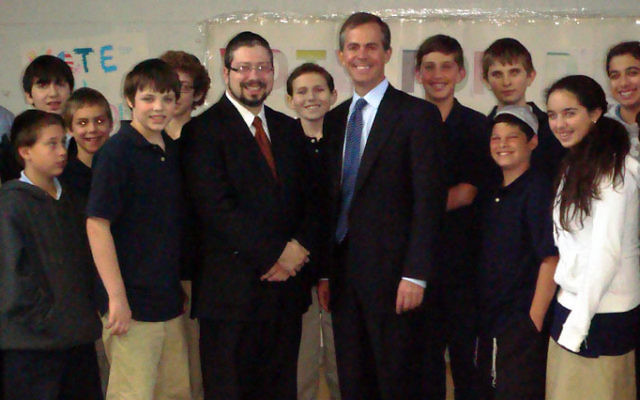 Republican challenger Scott Sipprelle, right, with headmaster Rabbi Moshe Bak and eighth-grade students he met with at Shalom Torah Academy in Morganville. Photo courtesy Shalom Torah Academy