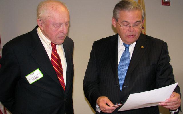 Veteran Lewis Bloom listens as Sen. Robert Menendez (D-NJ) reads a citation awarding the Plainsboro resident a Bronze Star for his service as an intelligence officer during World War II.
