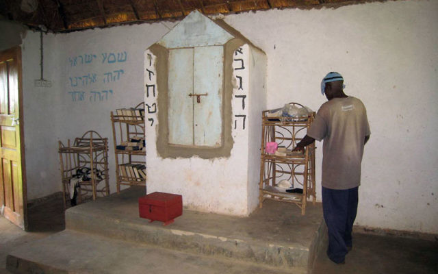 Rabbi Enosh Keki Mainah in the community synagogue in Putti, Uganda. Photos courtesy Jonathan Golden