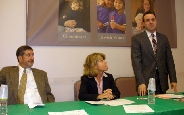 Taking part in a panel discussion on anti-Semitic incidents in Edison at the Jewish Federation of Greater Middlesex County are Etzion Neuer, director of the ADL's New Jersey region, standing; Martin Raffel, senior associate executive director of t
