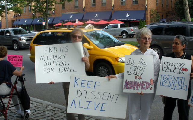 Protestors in New Brunswick, from left, Dottie Ji of East Brunswick, Marion Munk of Piscataway, and Manijeh Saba of Somerset, during a June 2 rally against Israeli actions on a flotilla that tried to break its blockade of Gaza. Photos by Debra Rub