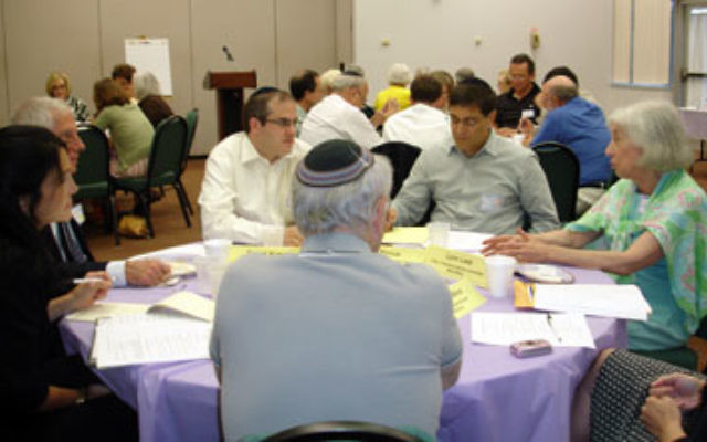 Representatives of the MetroWest, Central, and Northern NJ federations discuss the merger of their community relations arms at an August leadership retreat in Whippany.