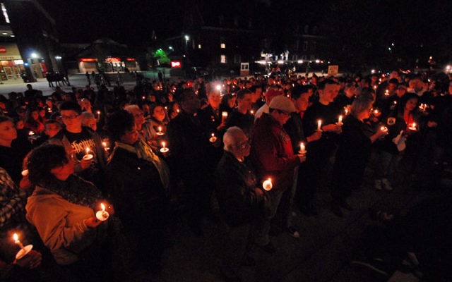 Hundreds gathered on the main campus at Rutgers University Oct. 3 at a vigil in memory of freshman Tyler Clementi. Photo by Jennifer Kong/Daily Targum Staff Photographer