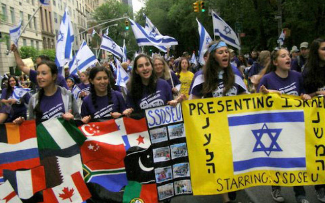 Over 100 students, parents, and teachers from Solomon Schechter Day School of Essex and Union marched in the parade, including, from left, Gabrielle Wolberger, Rafaella Schor, Rose Shapiro, Carmelle Bargad, and Rachel Gordon.
