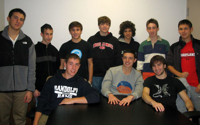 Local teens offered their reactions to a new study suggesting the need for a boys-only space to keep male youth engaged in Jewish life. Visiting the Aidekman campus Nov. 7 for the Global Day of Jewish Learning are, from left, top row, Jacob Fingeret, Be