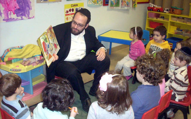 Rabbi Chaim Marcus spends some time with preschoolers at Congregation Israel in Springfield, which will be featured at the Orthodox Union's third Emerging Communities Fair March 27.