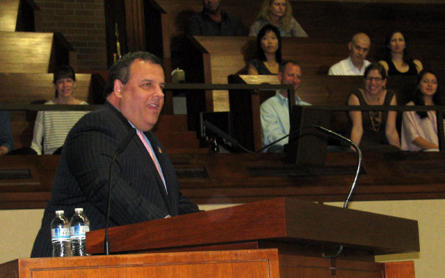 Gov. Chris Christie — whom union leader Christopher Shelton likened to Hitler — here addresses an audience at Temple B'nai Jeshurun in Short Hills on May 26. Photo by Robert Wiener