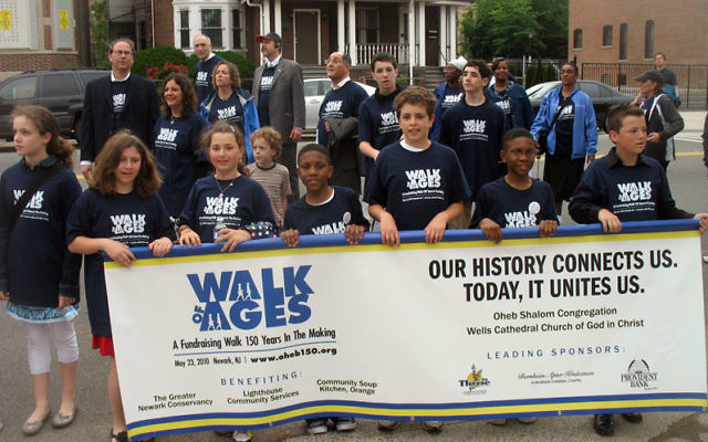 Children from Oheb Shalom and Wells Cathedral Church of God in Christ take part in the May 23 Walk of Ages, from the synagogue's original Prince Street location in Newark to its second location in the city, now home to the church. Photos by Johann