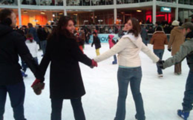 Residents of Moishe House in Hoboken host an ice skating event at Bryant Park in New York. Photo courtesy Josh Einstein
