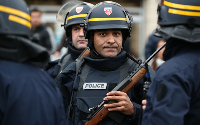 Police arrive with guns at Port de Vincennes on Jan. 9, 2015 in Paris. According to reports at least five people had been taken hostage in a kosher deli in the Port de Vincennes area of Paris. (Dan Kitwood/Getty Images)